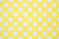Yellow wall and White Polka Dots. Background Stock Photo
