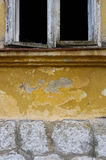 Yellow wall and white window. Stone,wall window... abandoned house Stock Images