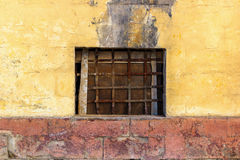 Yellow wall with window grid Royalty Free Stock Image