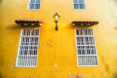Yellow Wall and Windows Stock Photography