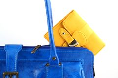 Yellow wallet in a handbag Stock Photo