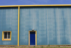 Yellow warehouse building Stock Photography