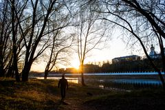Yellow, warm sunset on the banks of the Urals, and against the embankment of the city of Orenburg stock image