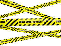 Yellow warning caution ribbon tape on white Royalty Free Stock Photography