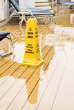 Yellow Warning Cone on Wet Deck Stock Photo
