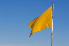 Yellow warning flag. This flag warns you to be careful in the sea royalty free stock photography