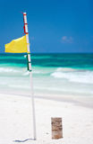 Yellow warning flag at beach Stock Photo