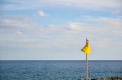 Yellow warning flag Royalty Free Stock Photo