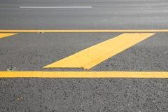 Yellow warning sign on asphalt road Stock Photo