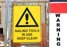 Yellow warning sign Stock Photography