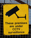 Yellow warning sign for CCTV surveillance Stock Images