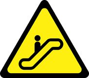 Yellow warning sign with escalator Royalty Free Stock Images