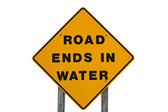 Yellow Warning Sign That States Road Ends In Water. Warning sign that says road ends in water Royalty Free Stock Photos
