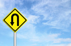 Yellow warning sign u-turn roadsign Stock Images
