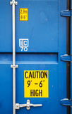 Yellow warning signs on blue container. Yellow warning signs on closed gate of standard blue cargo shipping container Stock Photography