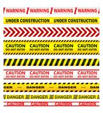 Yellow warning tapes with texts Royalty Free Stock Photography