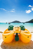 Yellow water bicycle berthed at the beach, with stunning view of Stock Photo