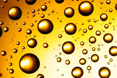 Yellow water drops Royalty Free Stock Image