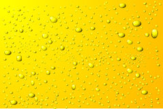 Yellow water drops background Royalty Free Stock Images