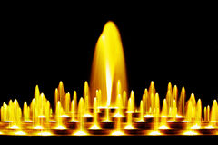 Yellow water fountain Royalty Free Stock Image