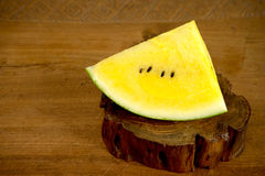 Yellow water mellon on wood teak Royalty Free Stock Image