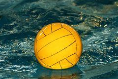 Yellow water-polo ball royalty free stock image