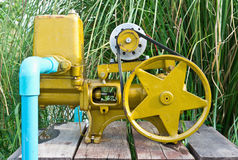 Yellow water pump Stock Photo
