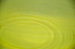 Yellow water. It`s a drop of the yellow water Stock Image