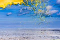 Yellow water splash royalty free stock photos