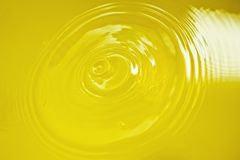 Yellow water surface close up Royalty Free Stock Images