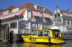 Yellow water taxi in Amsterdam, Netherlands Royalty Free Stock Images