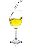 Yellow water in wine glass. isolated on a white background Royalty Free Stock Photo