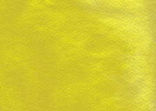 Yellow watercolor wash. This a glowing yellow wash on textured watercolor paper Stock Images