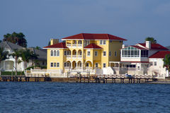 Yellow waterfront home. Stock Photography