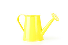 Yellow watering can Stock Images