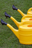 Yellow watering cans Royalty Free Stock Images