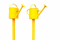 Yellow watering cans Stock Images