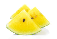Yellow watermelon  slice on white background. Royalty Free Stock Image