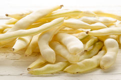 Yellow wax beans on a wood table Stock Image
