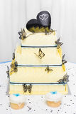 Yellow wedding cake made of white chocolate Royalty Free Stock Photos