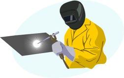 Yellow welder. Welder welding dressed in an orange jumpsuit and helmet type mask Royalty Free Stock Image