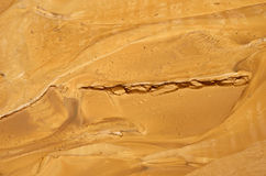 Yellow wet clay sediment. Yellow wet clay silt are photographed after a mud torrent. It is a rapid movement of a large mass of mud formed from loose soil and Royalty Free Stock Photo