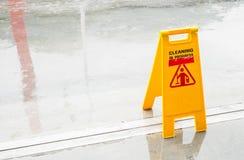 Yellow Wet Floor in rain season Stock Photo