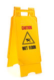 Yellow wet floor sign Stock Photo