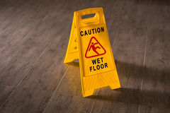 Yellow Wet Floor Sign. Caution wet floor and slippery surface sign Royalty Free Stock Image