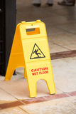 Yellow wet floor sign Royalty Free Stock Photos