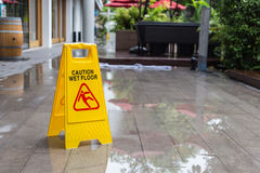 Yellow wet floor warning sign on the floor in hotel Stock Photography