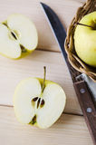 Yellow wet fresh apples in a wicker basket Royalty Free Stock Photography