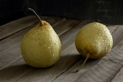 Yellow wet pear wooden background stock photos