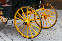 Yellow wheel of horse carriage Royalty Free Stock Photography